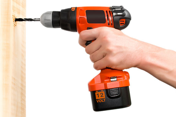 drilling a hole with a 12 volt electric drill