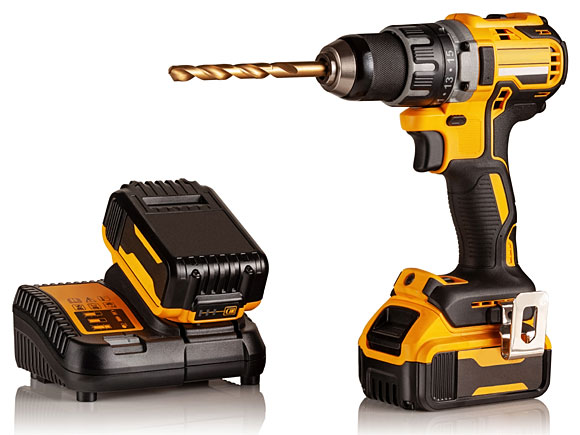 black and yellow cordless drill with battery charger and spare battery