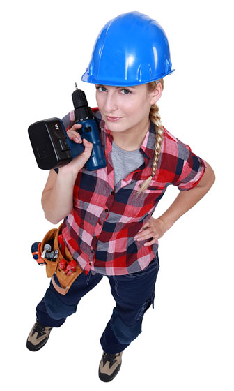 female carpenter holding a 12-volt cordless drill